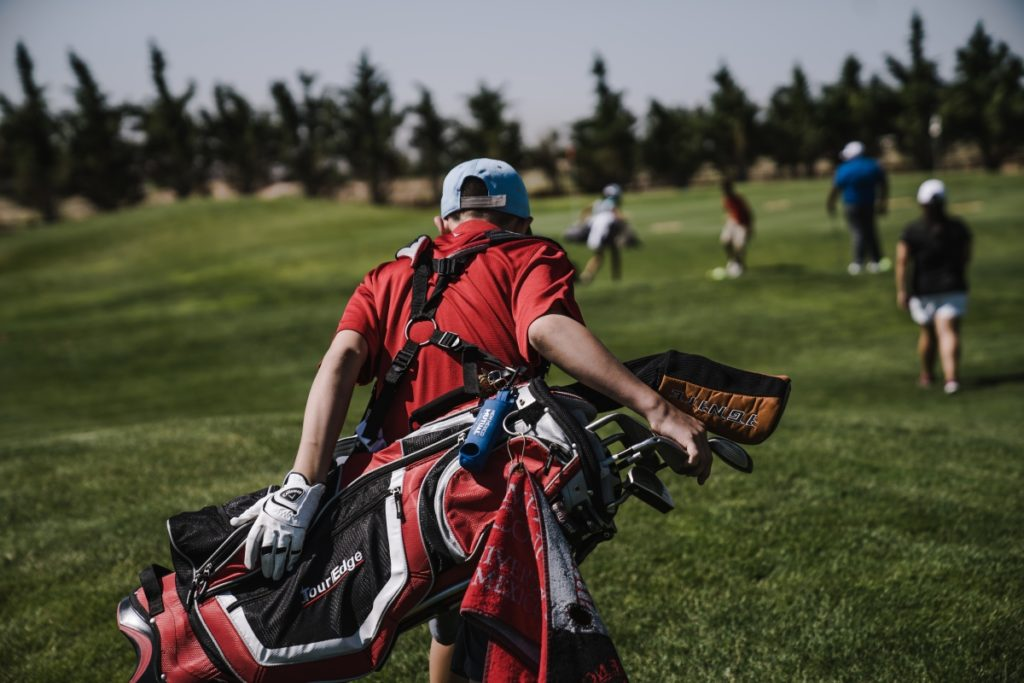 Golfer carrying bag
