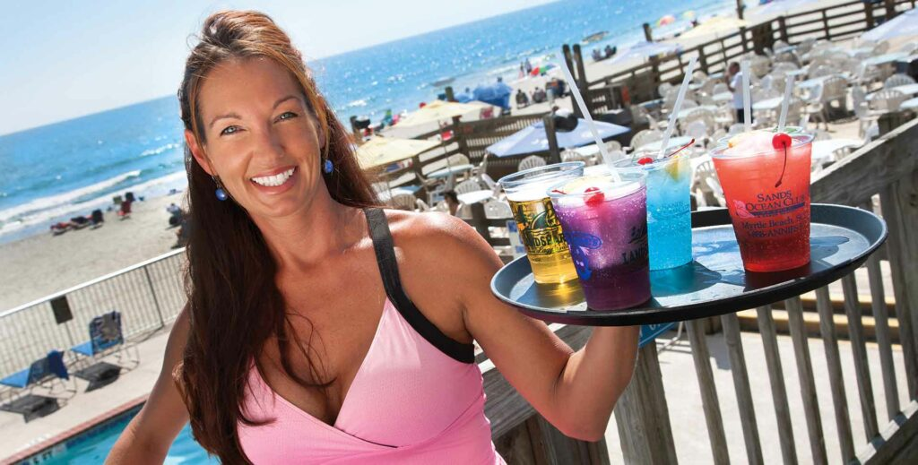 Waitress serving drinks at Ocean Annie's Bar and Grill