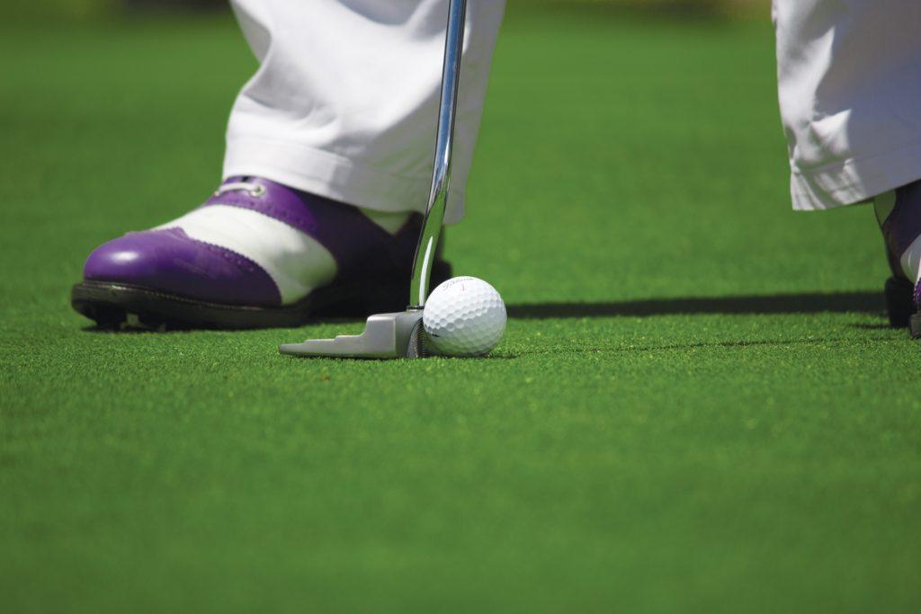 Golfer addresses short putt in Myrtle Beach