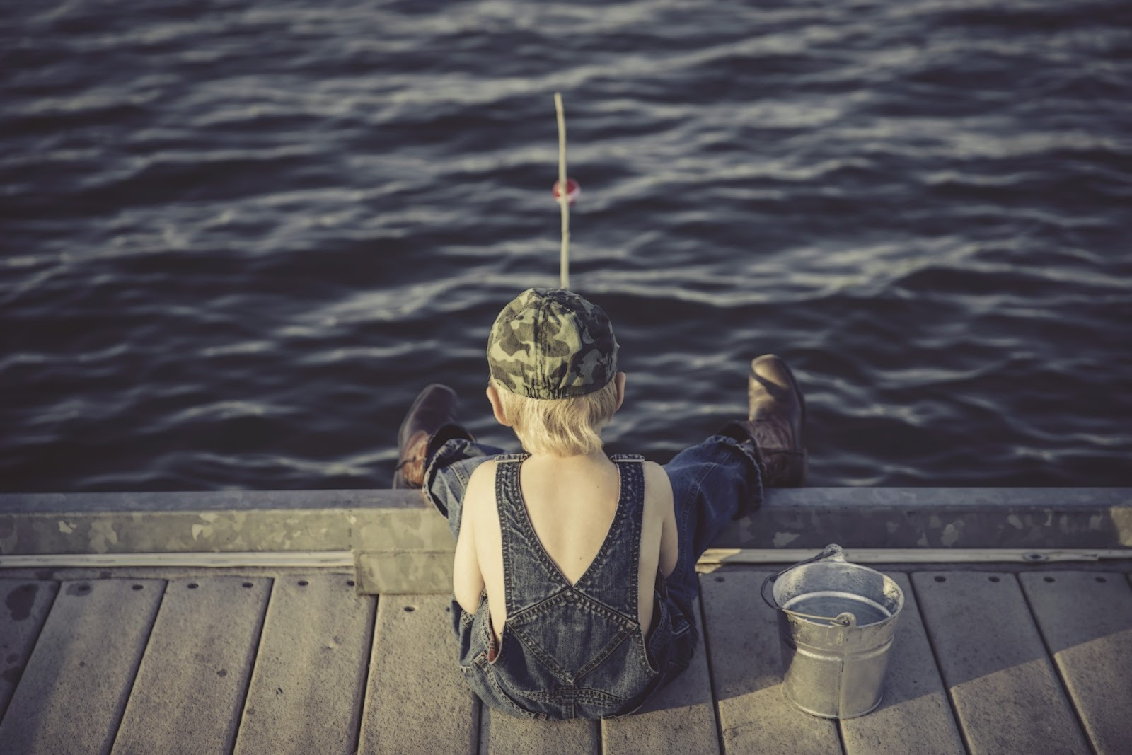 Boy fishing from dock in Calabash, NC
