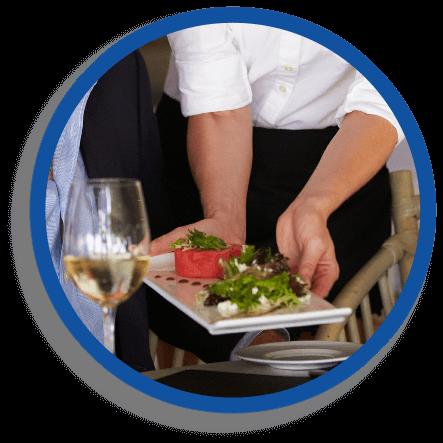 Waitress serving gourmet dinner