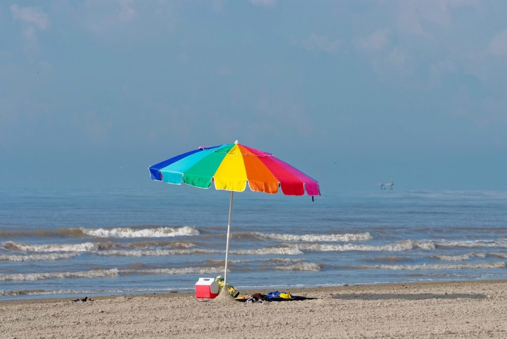Lone umbrella sits on the beach