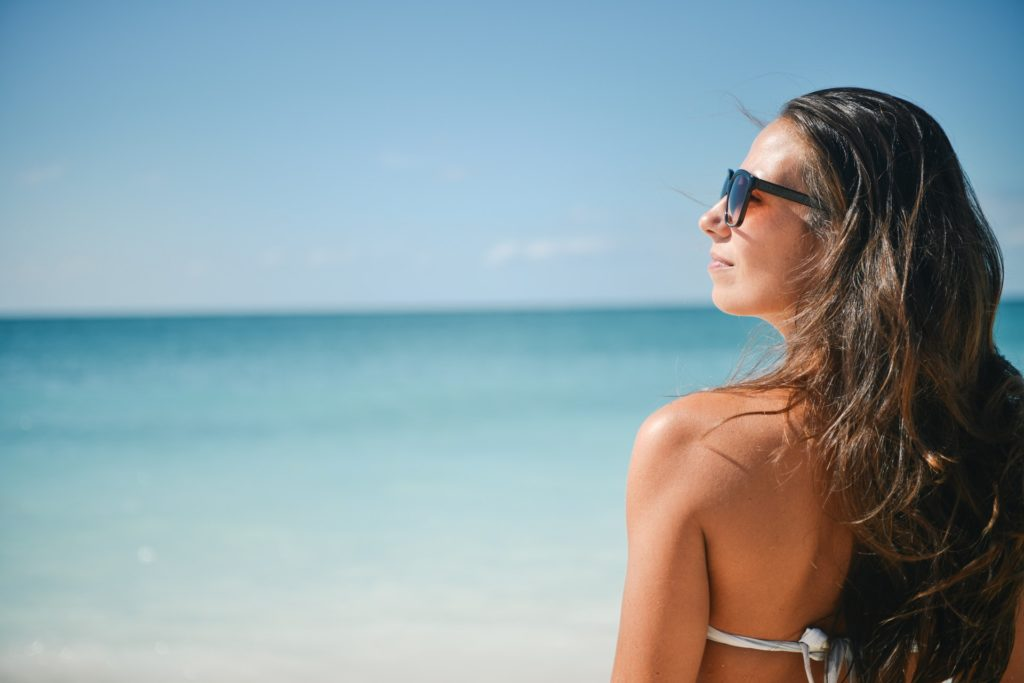 Profile of lady sitting on beach