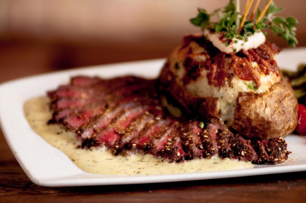 Steak au poivre served