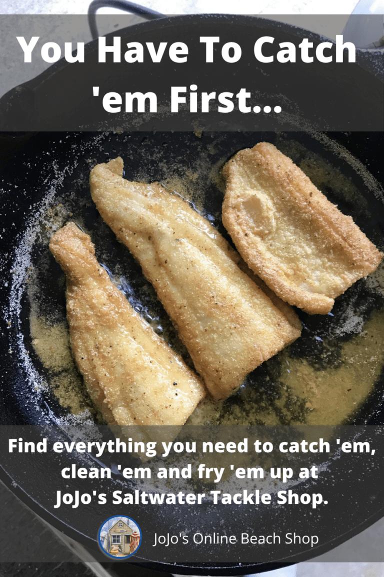 fish frying in iron skillet