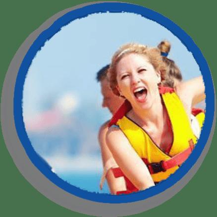 girl riding banana boat