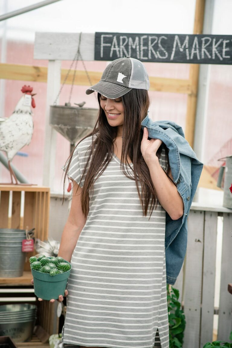 girl wearing Ball cap with t shirt dress