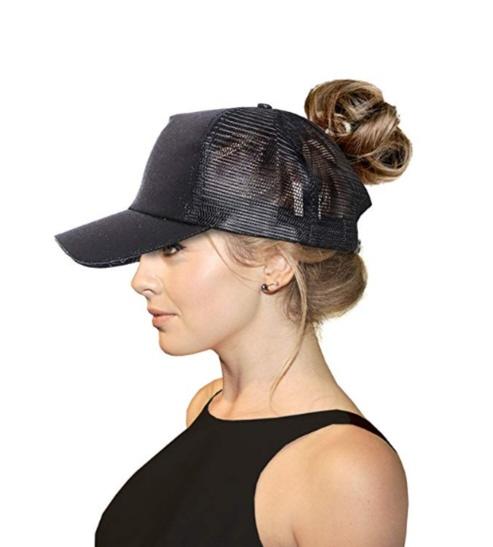 Women wearing hair in ponytail with baseball cap