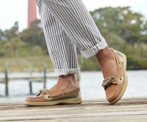 Lady models boat shoes on dock
