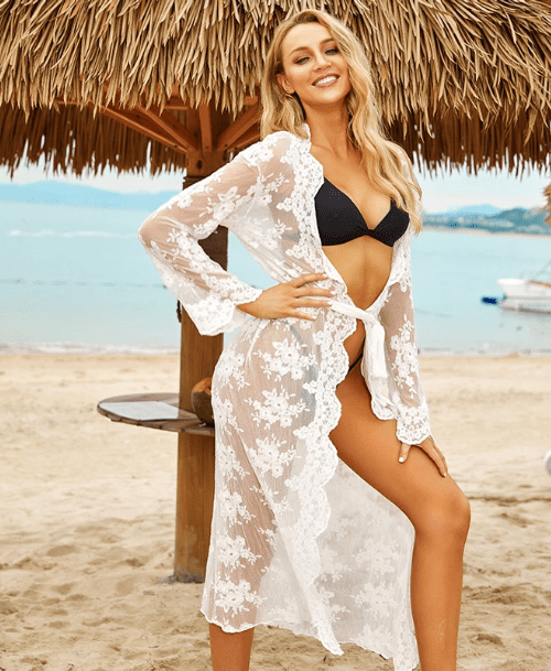 Lady on beach wearing belted cover up