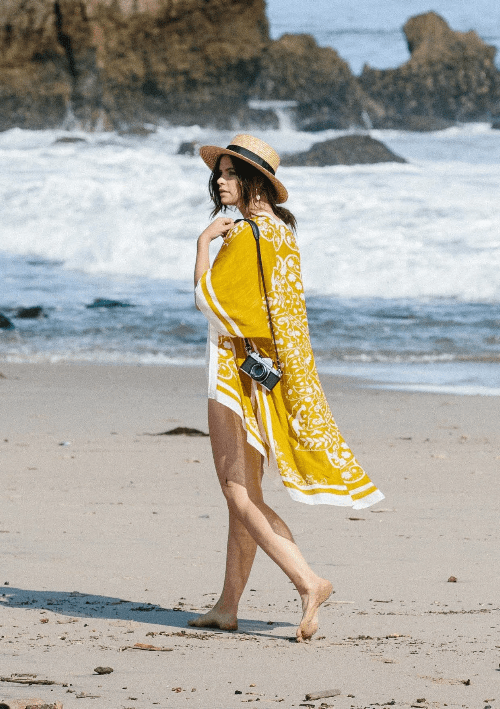 Woman on beach wearing kimono cover-up