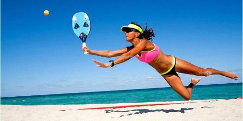 Girl playing beach tennis