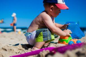 Little boy building sand castle