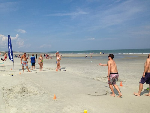 people playing TidalBall on the beach