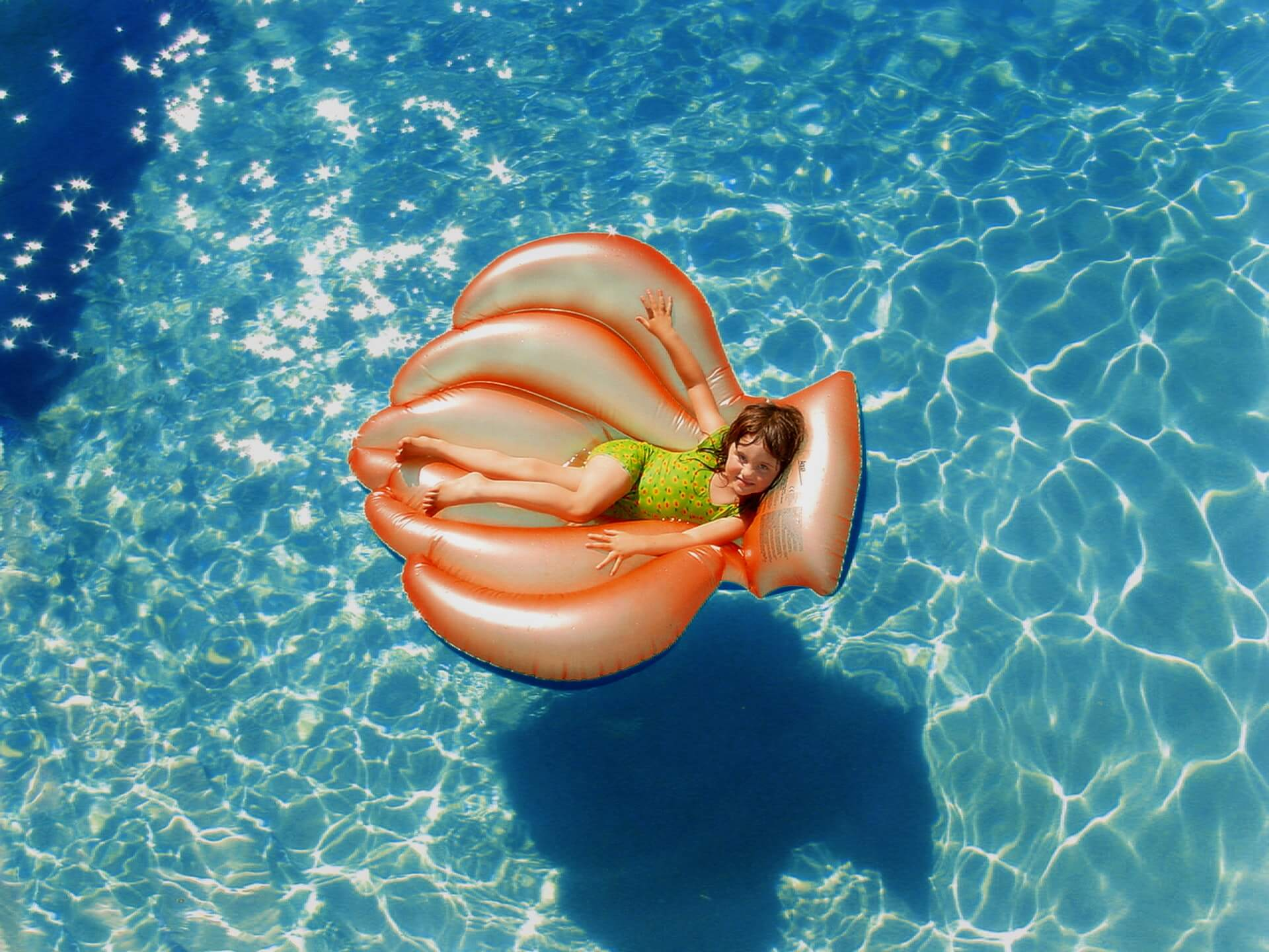 Young girl sits on pool float during vacation in Myrtle Beach