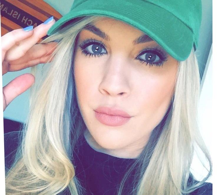 blonde girl wearing ball cap