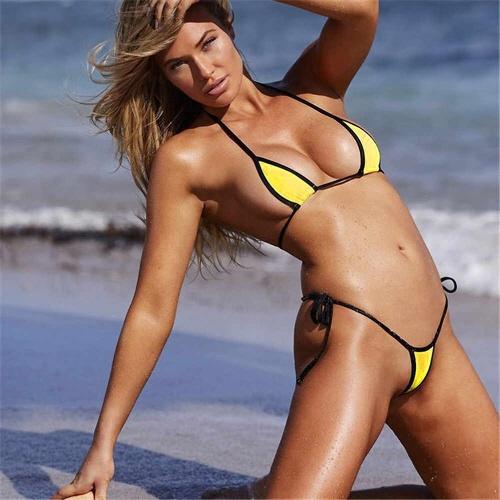 Girl wearing tiny yellow thong bikini on beach