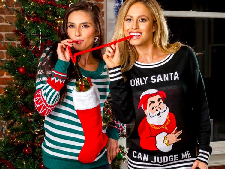 Ladies wearing Christmas sweaters