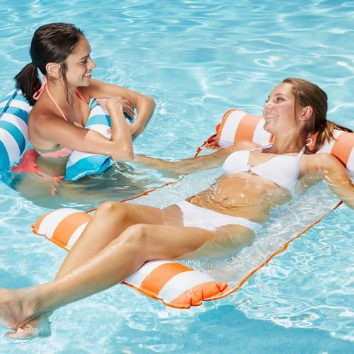 two ladies on floats in a swimming pool